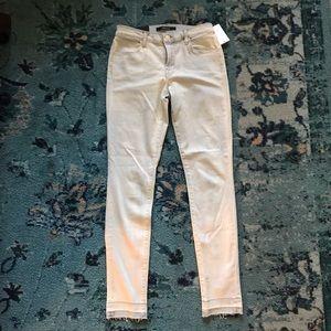 J Brand super skinny mid-rise light wash jeans